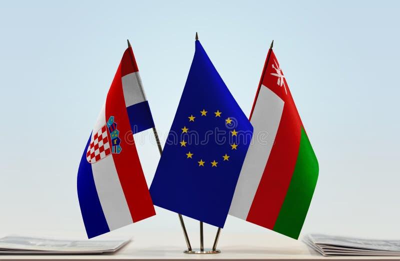 Flaggor av Kroatien EU och Oman arkivbilder