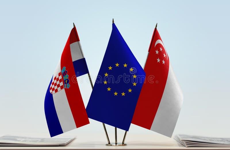 Flaggor av KroatienEU och Singapore arkivbild