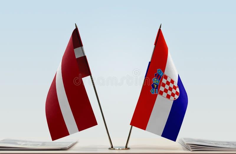 Flaggor av Lettland och Kroatien royaltyfri foto