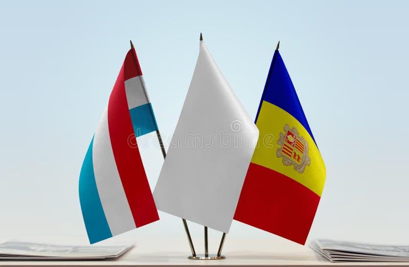 Flaggor av Luxembourg och Andorra fotografering för bildbyråer