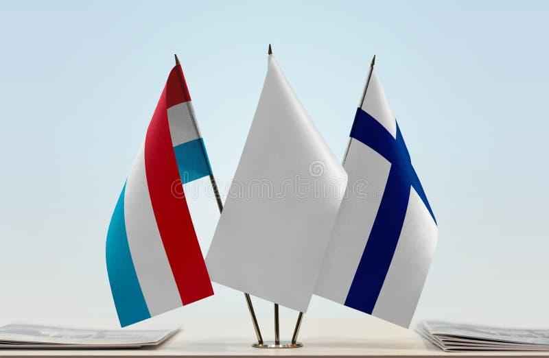 Flaggor av Luxembourg och Finland royaltyfri bild