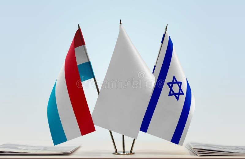 Flaggor av Luxembourg och Israel royaltyfri fotografi