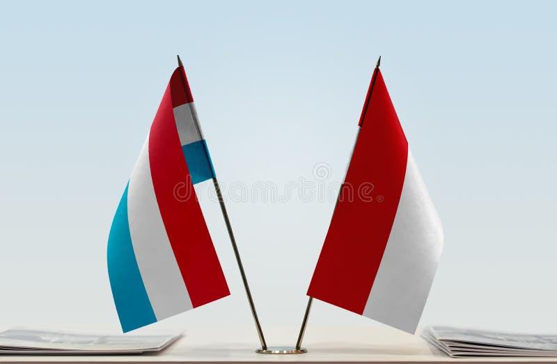 Flaggor av Luxembourg och Monaco arkivbilder