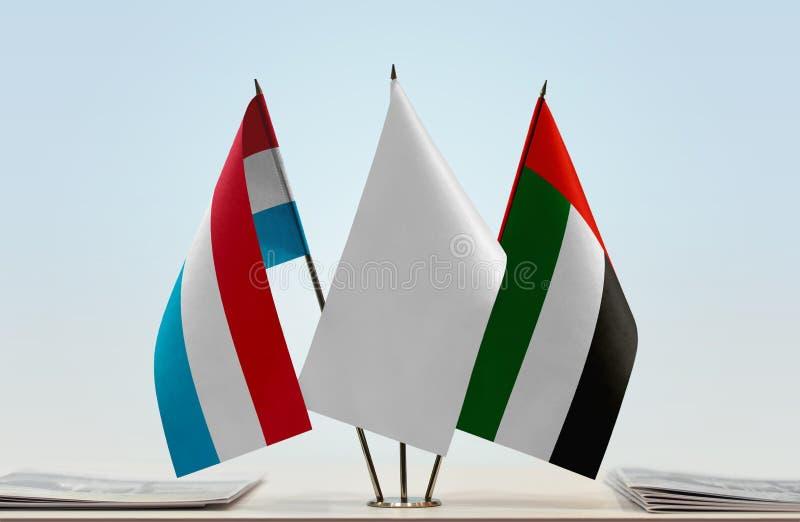 Flaggor av Luxembourg och UAE fotografering för bildbyråer