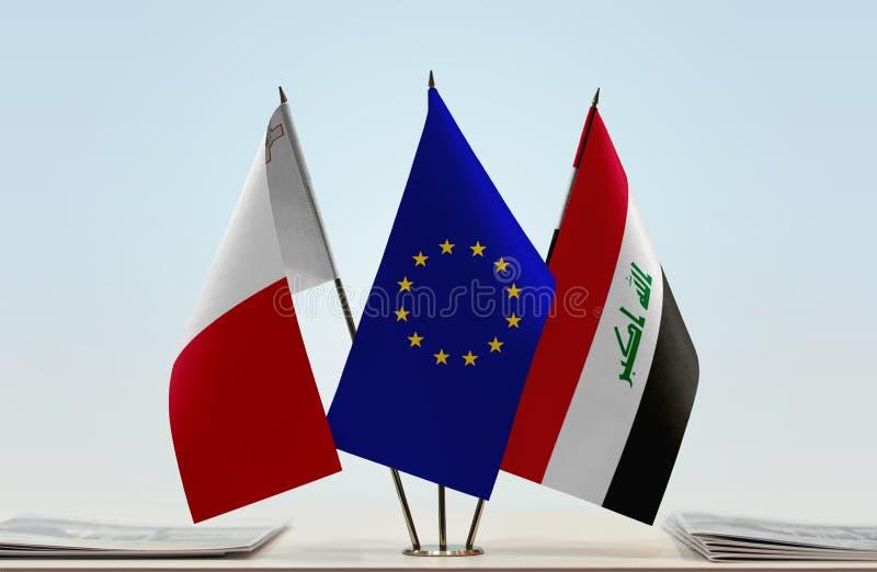 Flaggor av Malta EU och Irak arkivfoton
