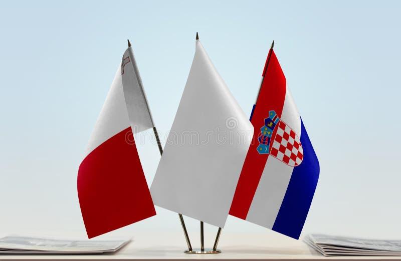 Flaggor av Malta och Kroatien royaltyfri fotografi