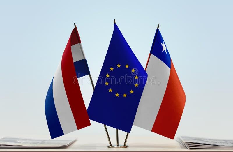 Flaggor av Nederländerna EU och Chile arkivfoto