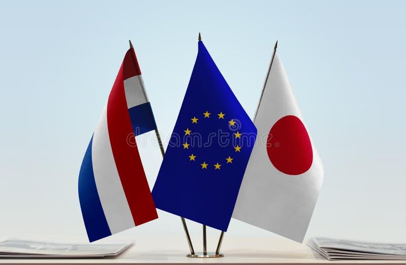 Flaggor av Nederländerna EU och Japan fotografering för bildbyråer