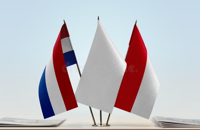 Flaggor av Nederländerna och Monaco arkivfoto