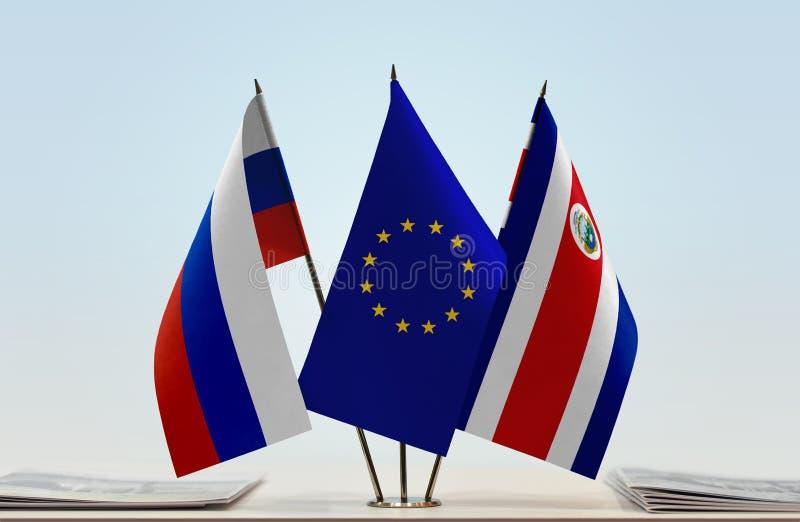 Flaggor av Ryssland EU och Costa Rica royaltyfri fotografi