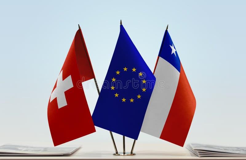 Flaggor av Schweiz EU och Chile arkivfoto