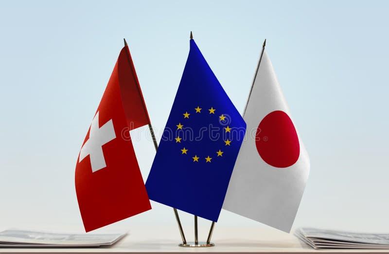 Flaggor av Schweiz EU och Japan royaltyfri bild
