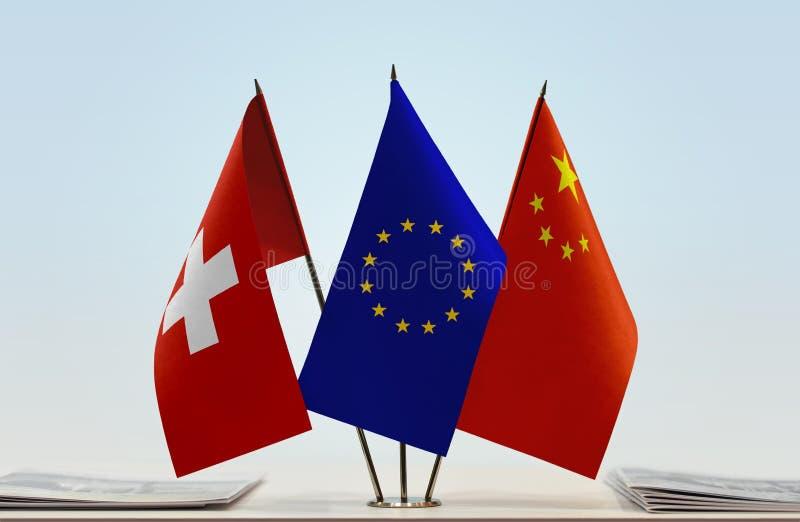 Flaggor av Schweiz EU och Kina arkivbilder