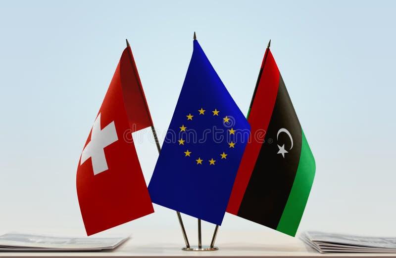 Flaggor av Schweiz EU och Libyen arkivfoto