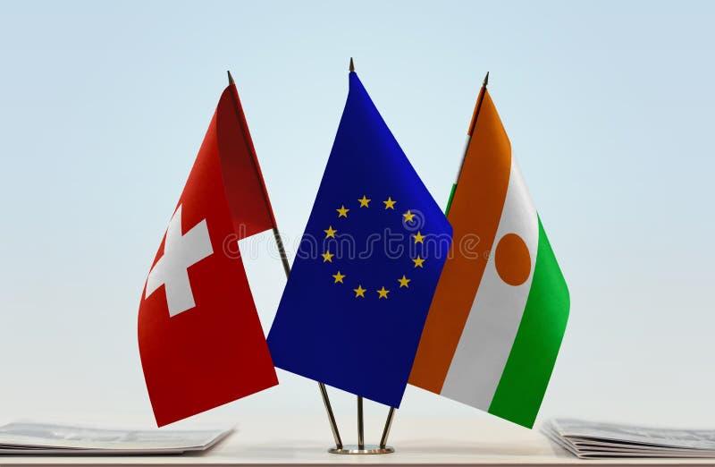Flaggor av Schweiz EU och Niger arkivfoton