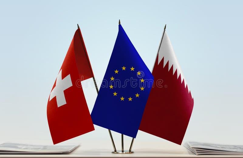Flaggor av Schweiz EU och Qatar arkivbilder