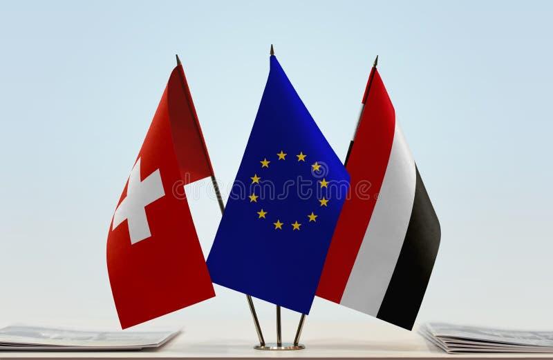 Flaggor av Schweiz EU och Yemen fotografering för bildbyråer