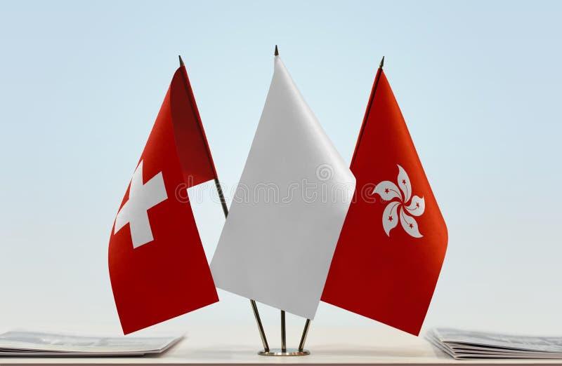 Flaggor av Schweiz och Hong Kong royaltyfria foton