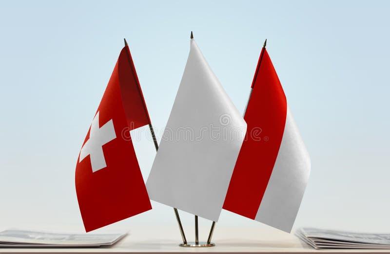 Flaggor av Schweiz och Indonesien royaltyfria foton