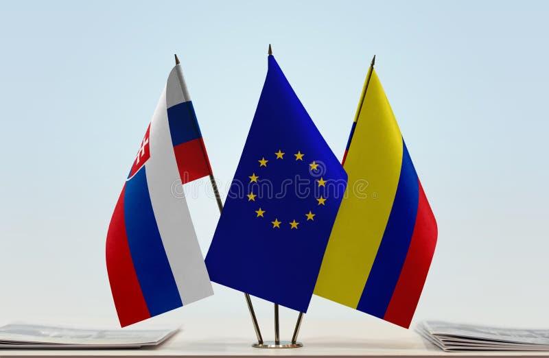 Flaggor av Slovakien EU och Colombia fotografering för bildbyråer