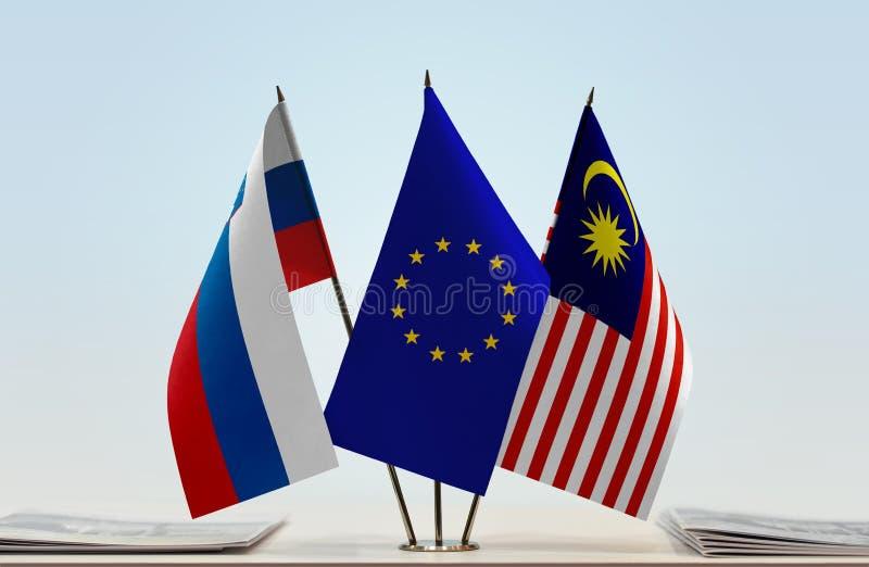Flaggor av Slovenien EU och Malaysia royaltyfria foton