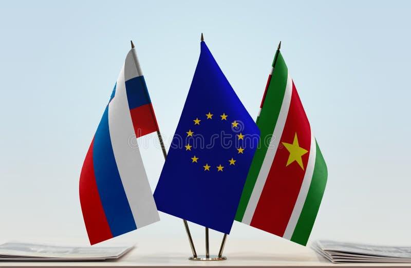 Flaggor av Slovenien EU och Surinam arkivbilder