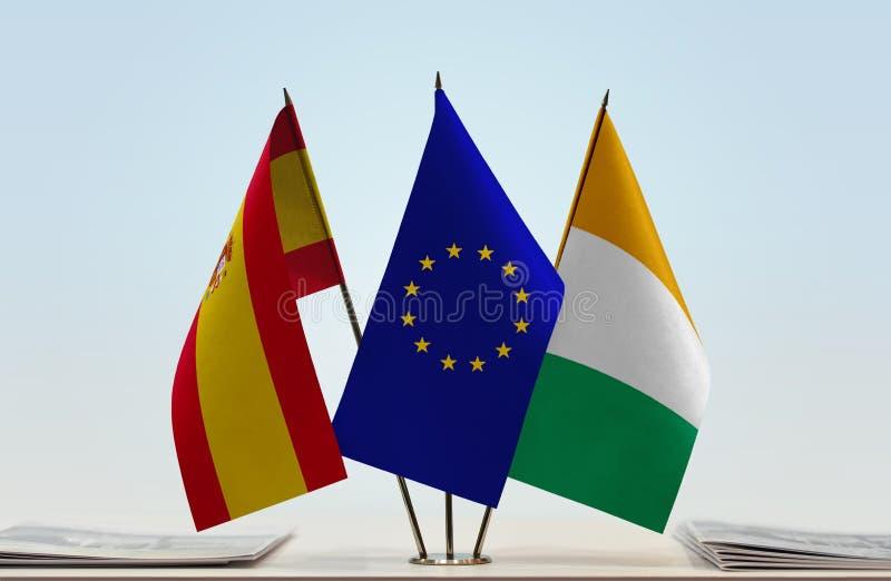 Flaggor av Spanien EU och Elfenbenskusten royaltyfri foto