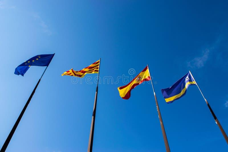 Flaggor av staden av Salou, Spanien, Catalonia och den europeiska unionen royaltyfria bilder