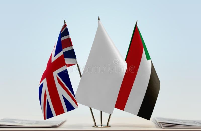 Flaggor av Storbritannien och Sudan fotografering för bildbyråer