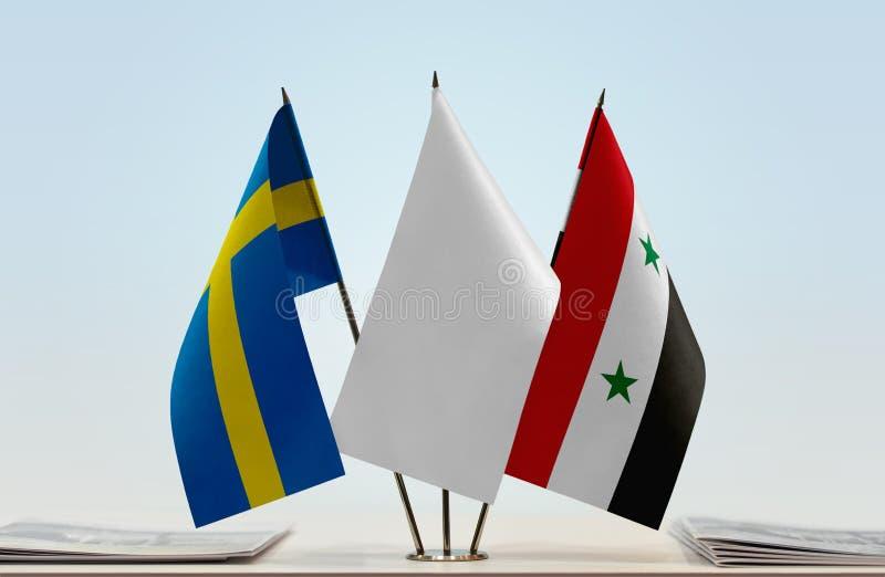 Flaggor av Sverige och Syrien royaltyfri bild