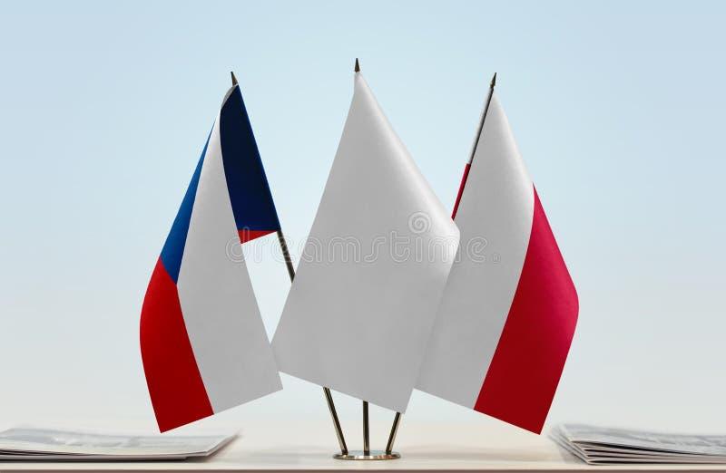 Flaggor av Tjeckien och Polen royaltyfri foto