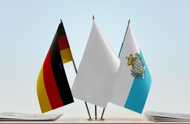 Flaggor av Tyskland och San Marino royaltyfria foton