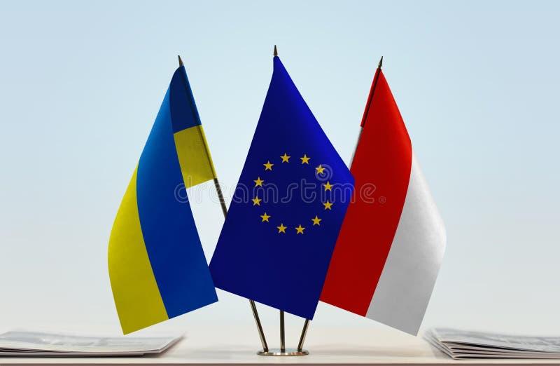 Flaggor av Ukraina EU och Indonesien royaltyfri bild