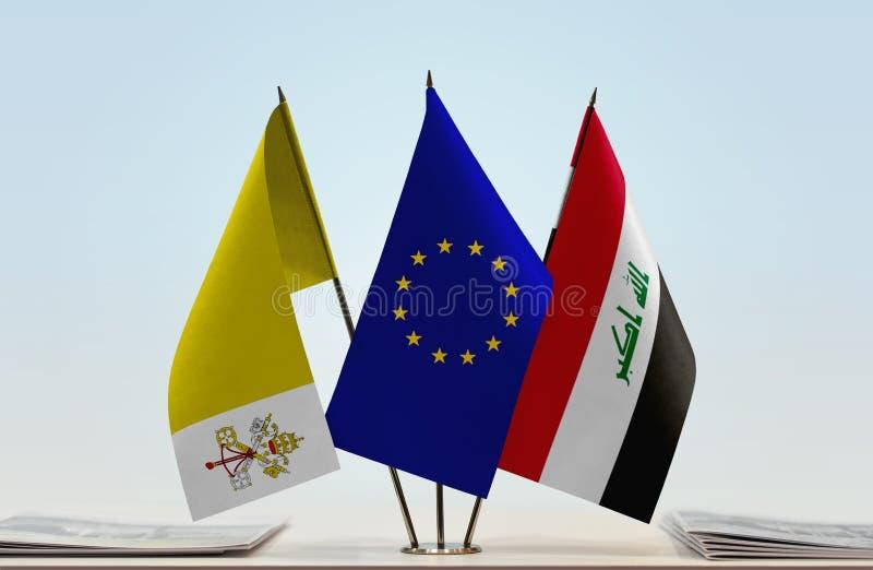 Flaggor av Vatican City EU och Irak arkivfoto