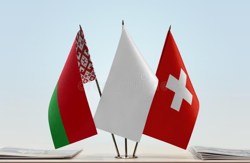 Flaggor av Vitryssland och Schweiz arkivfoto