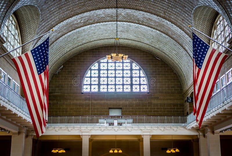 Flaggor inre Ellis Island royaltyfri foto
