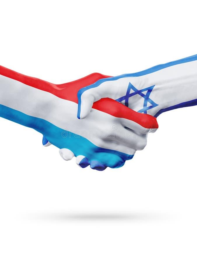 Flaggor Luxembourg, Israel länder, begrepp för partnerskapkamratskaphandskakning arkivfoton