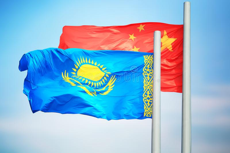 Flagi Chin i Kazachstanu zdjęcia royalty free