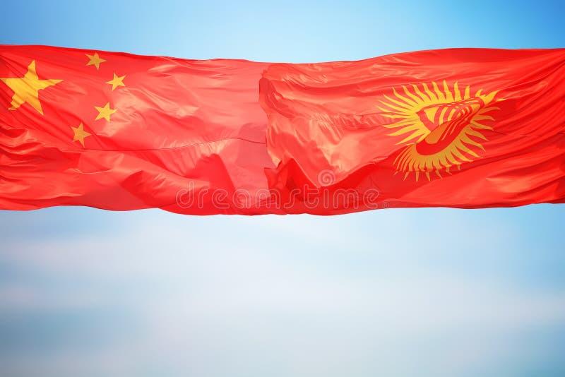 Flagi Chin i Kirgistanu zdjęcia royalty free