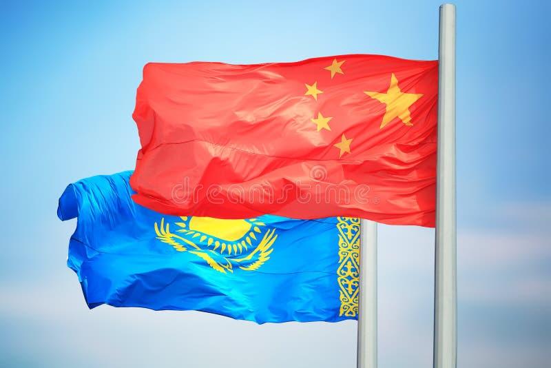 Flagi Kazachstanu i Chin obrazy royalty free