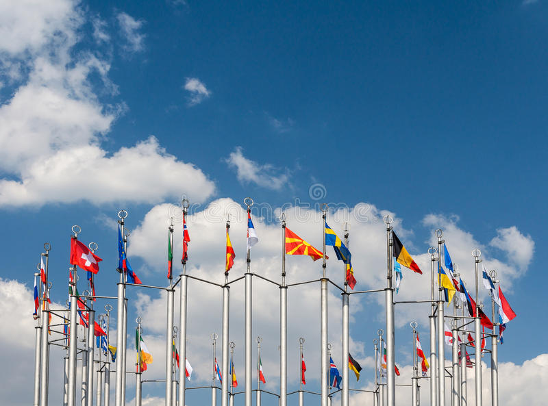 Flagpoles on the background of blue sky royalty free stock images