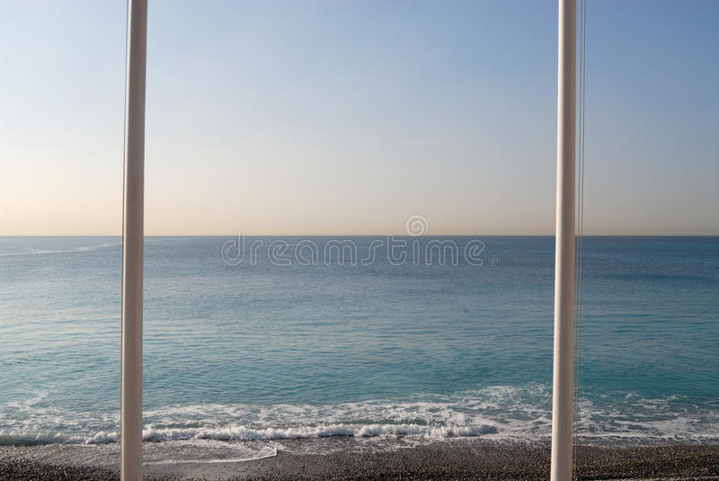 Flagpoles at the Mediterranean Sea. Location City of Nice, France royalty free stock photography
