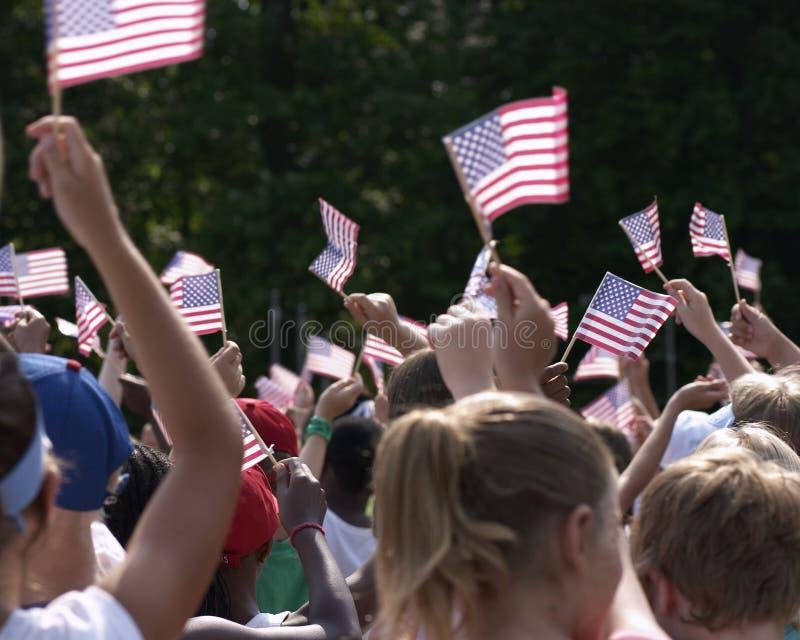 Flags. Kids waving american flags