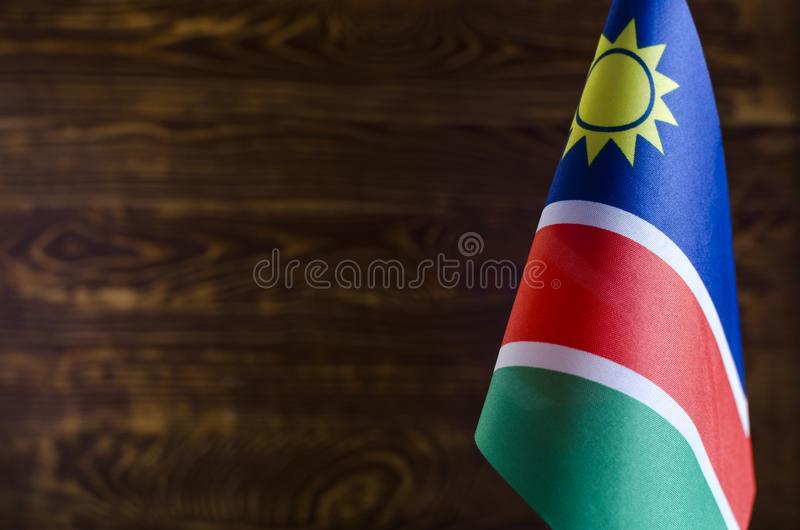 Flags of African countries Fragment of the flag of Namibia in the foreground space for text blurred background flag of the Republ images libres de droits