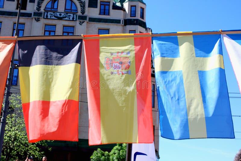 Flags of belguim, spain, sweden royalty free stock photos