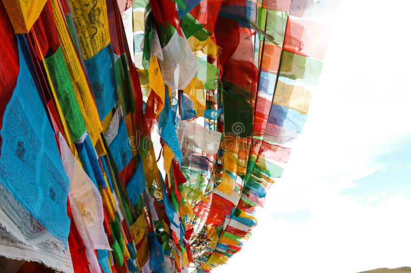 The flags. We can often see such a flag in Tibet, the Tibetan peoples mind, the flags is driven with the wind, just read again the above mantra says royalty free stock image
