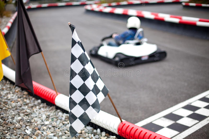 Flags and cars on carting track stock photos