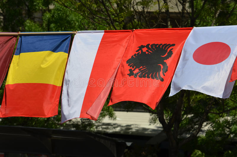 The flags of Chad, Monaco, Albania and Japan stock photography