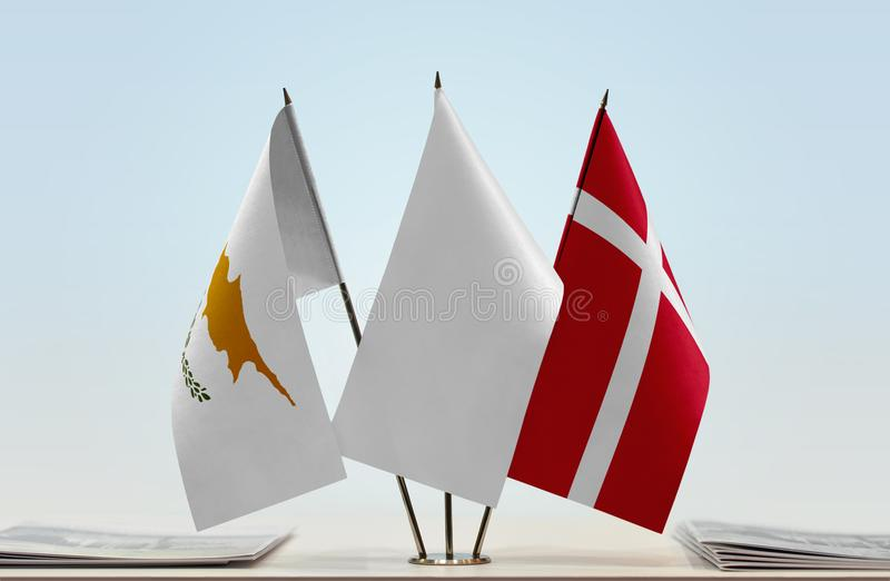 Flags of Cyprus and Denmark. Desktop flags of Cyprus and Denmark and white flag in the middle vector illustration