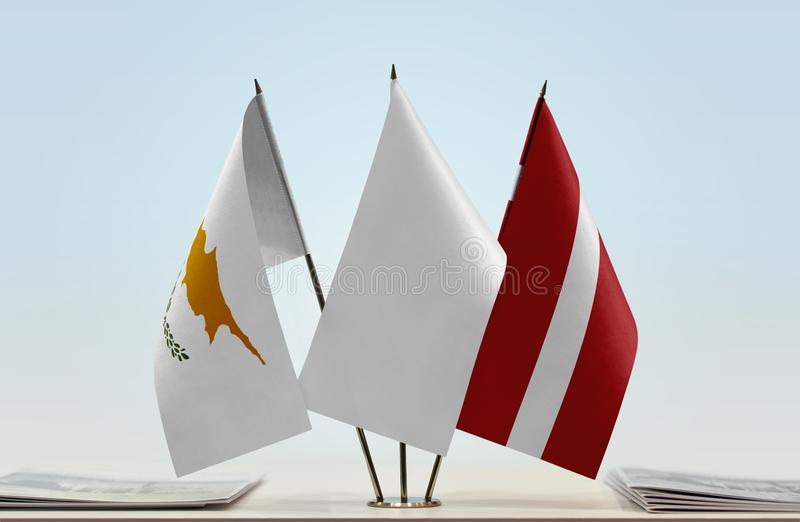 Flags of Cyprus and Latvia. Desktop flags of Cyprus and Latvia and white flag in the middle vector illustration
